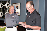 Dick Harrold (left) accepts the Volunteer of the Year award from Tennis Club President Rick Kenny.