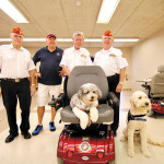 Ron Enderle, Pat Rice, Dave Althoff and Dave Minick with PowerPaws trainees.