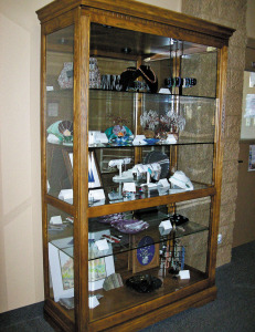 Come take a peek at the rock and glass jewelry and arts on display!