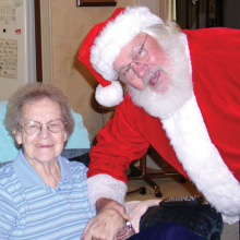 Santa visits a client of Neighbors Who Care!