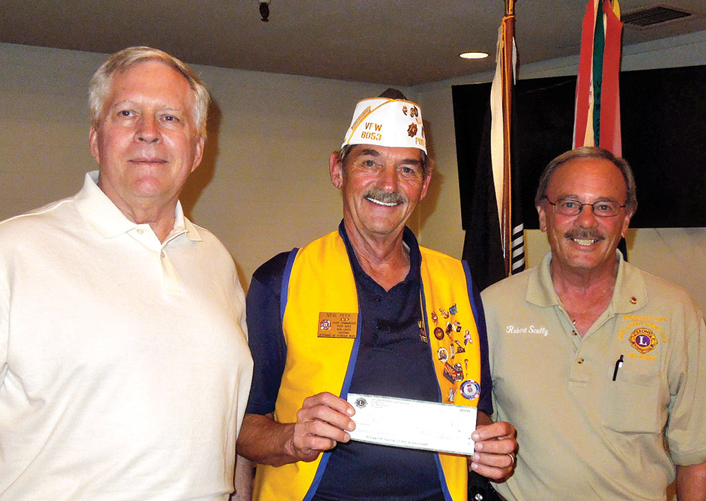 Lions Club members Garner and Sully with Commander Peer