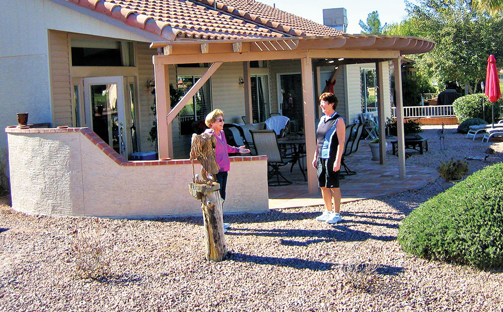 Donna Bergmann and Jennifer Walden share a laugh while discussing the upcoming March 8 Garden Club Home Tour. Tickets will be on sale at the HOA office.