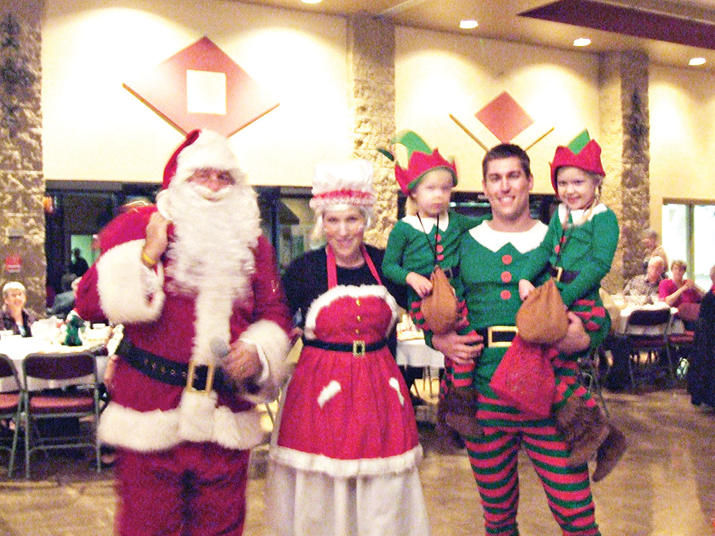 Santa and his elves attended the Lady 18ers Holiday Social!.