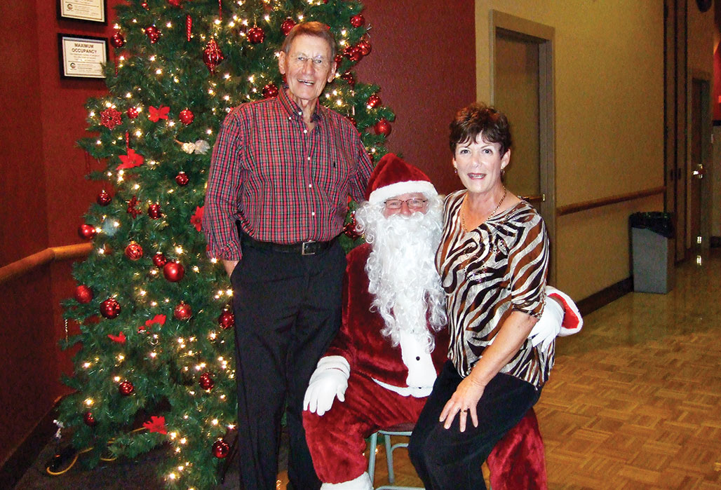 Pictured is the 2015 President of the Tennis Club, Dave Walden. and the new Vice-President, Jen Walden with the great looking Santa (Larry Buehler).