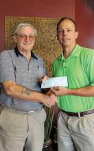Fred Garmeson presenting a check To Layne Varney