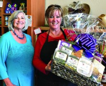 Participant Denise McCreery, owner of D'vine Gourmet with Vendor Fair Event Chairman Sue Reynhout.