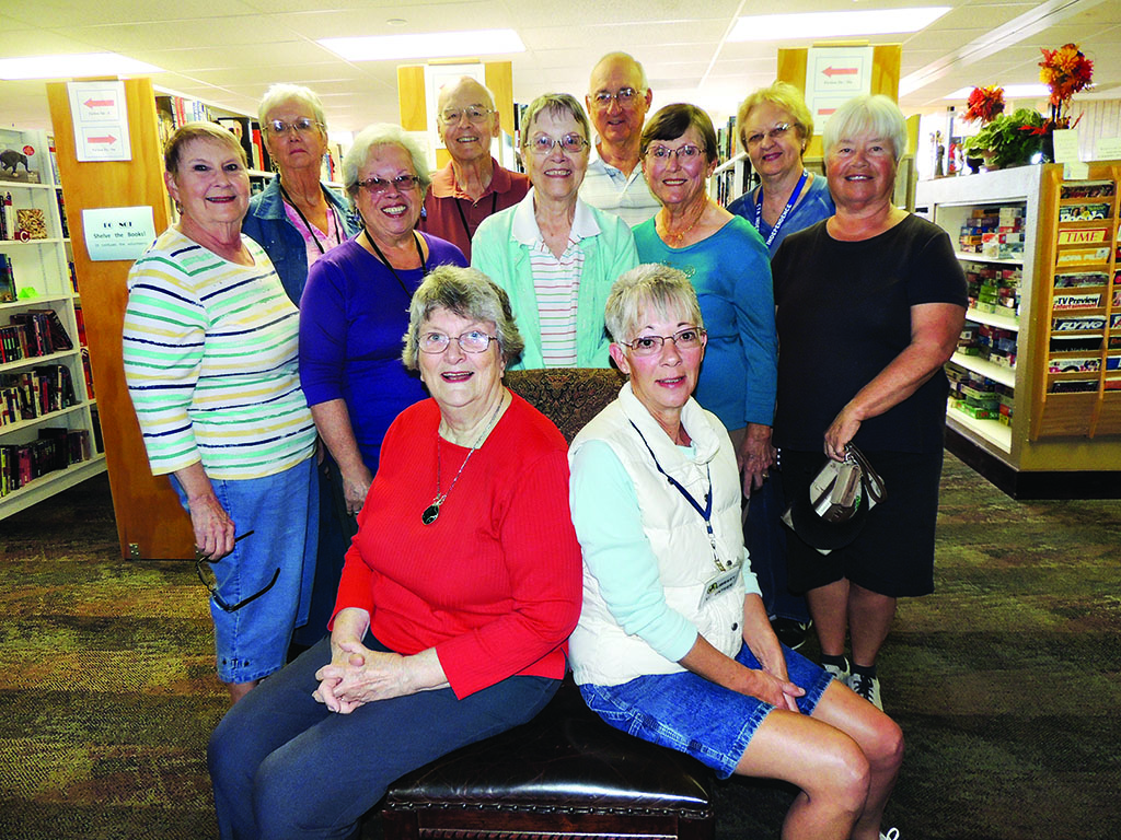 SunBird Library volunteers: Dosha Davidson, Bob Smith, Howard Anderson and Shirley Jackson (back row left to right); Katherine Gibbs, Margaret Speer, Nancy Smith, Marilyn Klooster and Carole Elton (second row left to right) and Lois Anderson and Sherry Fann (front row left to right); absent was Karlene Garn and Dianne Reed.