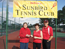 Pictured to the left is Jean Mrugala, President of the SunBird Garden Club, accepting a cash donation from the President and Vice President of the Tennis Club, Dave and Jen Walden. Jean was very excited to accept the contribution to use towards their future projects.