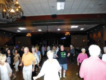 Line dancing to the music of Thaddeus Rose