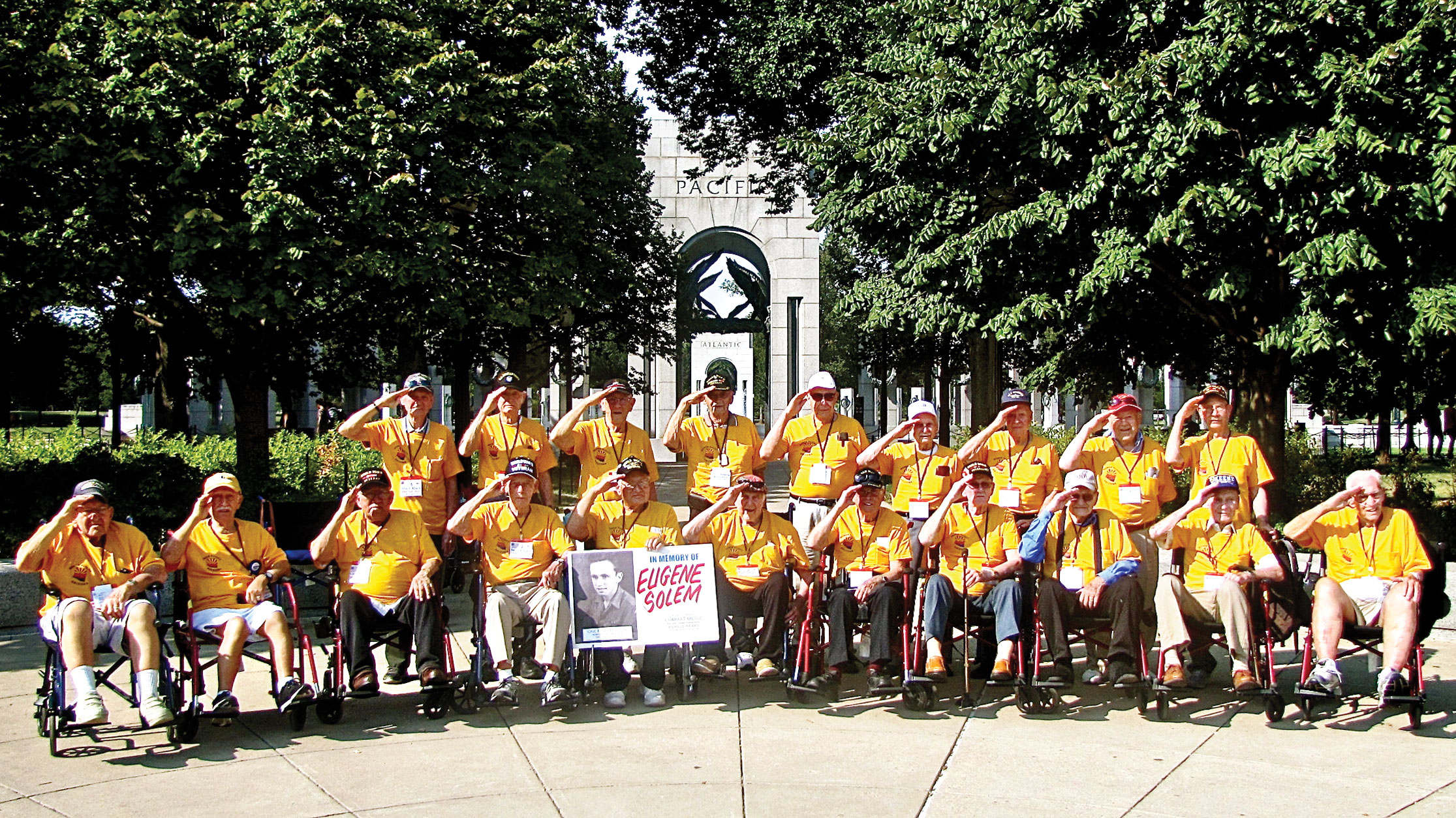Van Christman (front row, fourth from left) holds a salute along with other members of his Honor Flight Arizona group at the World War II Memorial in Washington, D.C.