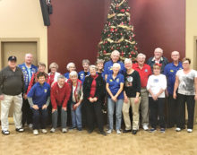 Members of the Chandler SunBird Lions Club celebrating Christmas with a potluck dinner and games.