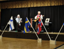 Celebrating our Scandinavian heritage with the five countries flags and national anthems on March 17 are Sylvia Jorgensen and Carl Nyberg.
