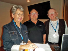 Computer Booters Club President Janet Quade (left) with February's guest speaker Bill Evans and club Secretary Ed Nowe