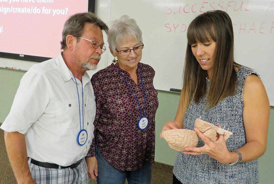 Dr. Sydney Schaefer (right), neuroscientist from ASU, talks with Matt and Sue Niesz about the workings of the brain. This summer, Dr. Schaefer and her graduate students will present a special New Adventures' session on the latest research on the aging brain.