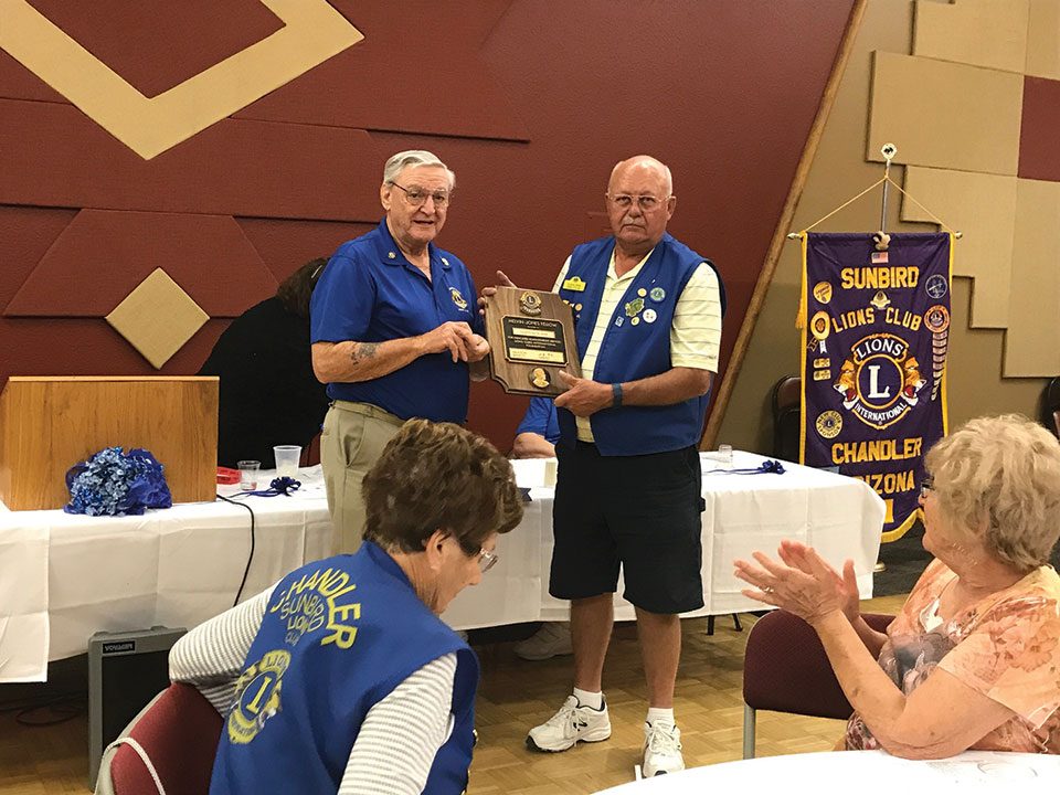 SunBird resident Gordon Olson is presented the Melvin Jones Fellow International Award by fellow Lion member Fred Garmeson. This award is given to a member for outstanding service to their community.