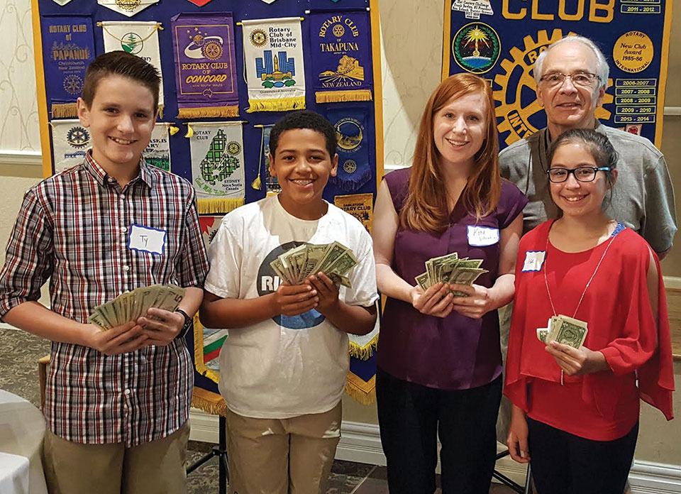 Pictured (left to right) are Ty Schmidt, Kade McIntyre, Katie Villaorduna (teacher) and Isa Mullen with Sun Lakes Rotary Club President Bill McCoach.