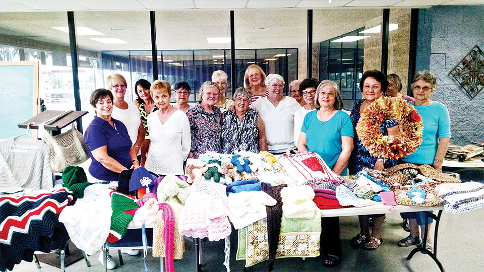The SunBird Yarn Club shows off their handiwork.