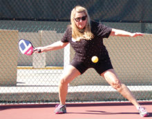 Darlene Dolich hits a return during the championship match.