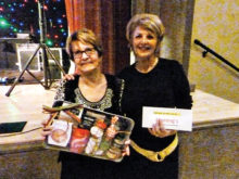 April's door prize winners (left to right): Idhidey Hunter (not pictured), Lynn Story, Barb Green