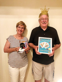 Pictured are Dog House Loser Jackie Morgan and Crowned King Neil Donohoe for the Aug. 6 euchre party.