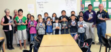 St. Bonaventure 3rd grade students holding their new dictionaries.