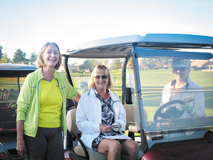 Karen DeLong sends off golfers Darlene Google and Elaine Friesen. More than 50 Lady 18ers came out for opening day.