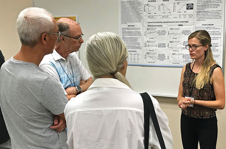 Classes are only one of the benefits of membership. Here, Melissa Walsh (right) from ASU describes her research on aging.