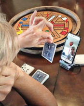 Mary Murphy and Suzanne Popelka play Fasttrack via FaceTime to keep social distancing here in SunBird.