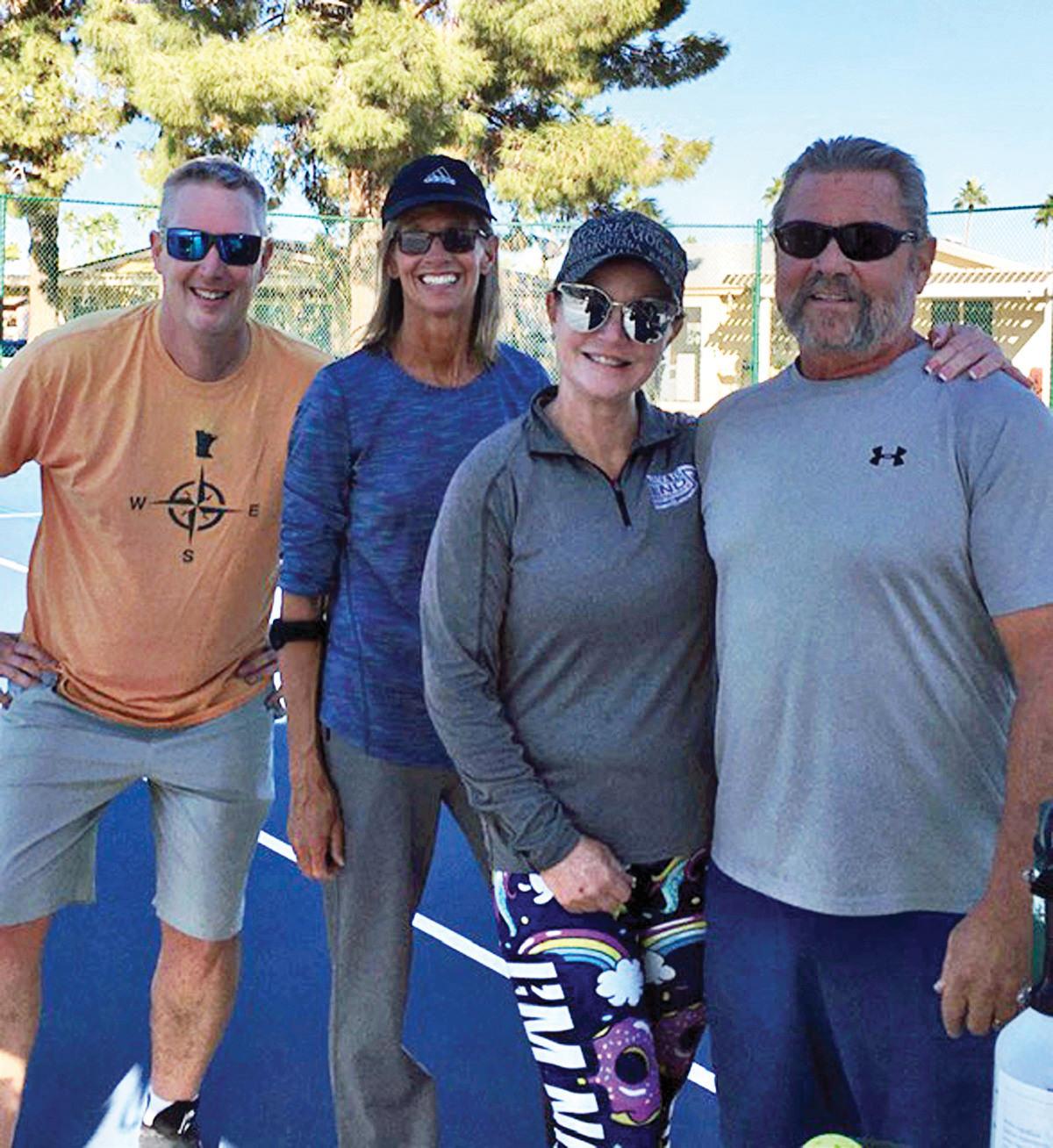 Brad Taylor, Lisa Dingeldein, Marianna Buescher, and Dan Buescher