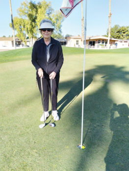 Pictured is Joan Seaman after getting a hole-in-one.